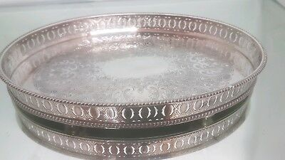 A magnificent vintage silver plated gallery tray with beautiful patterns.ornate.