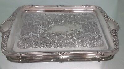 A very elegant vintage silver plated serving tray with decorated patterns.