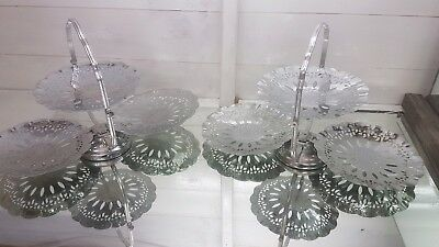 A pair of matching silver plated 3 tier folding cake stands with patterns.ornate
