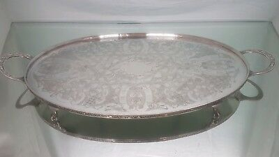 A large vintage silver plated chased tray on clawed legs by viners of sheffield.