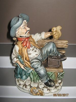 Ceramic figurine old man  no1 on seat with squirrel size 140 to 185 mm ex/cond