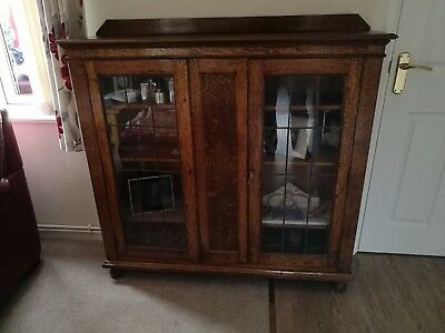 Old bookcase with glazed doors and 3 shelves