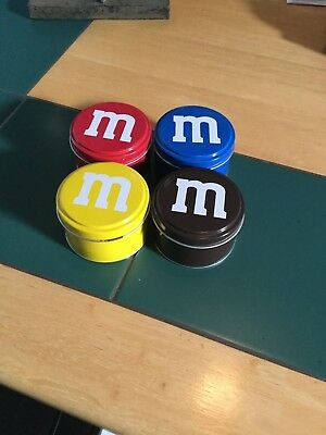 "M&m 4 plain tin can yellow/brown/ red/blue 2"" tall x 3"""" wide new"