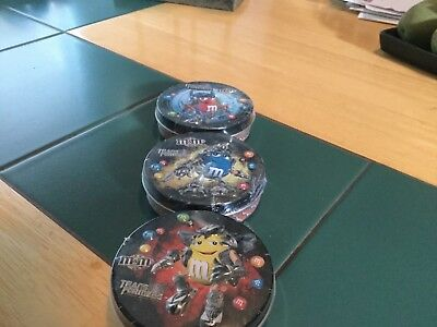 "M&m 3 transformers tin cans red/ blue/ yellow 3/4"" tall x 3"" wide new sealed"