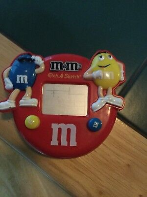 M&M etch a sketch red   with blue  &yellow fun size candy inside works