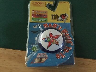 M&M world yo -yo trick book inside blue with all characters still sealed