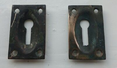 pair of old industrial 1950s brass key hole plates
