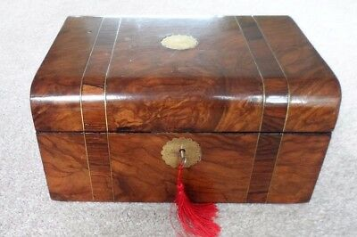 Antique walnut and rosewood banded writing slope with inlaid brass stringing.