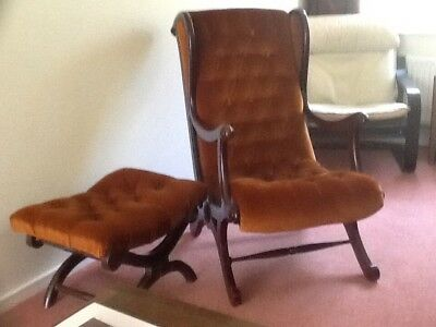 Mahogany slipper chair (rust coloured) with footstool
