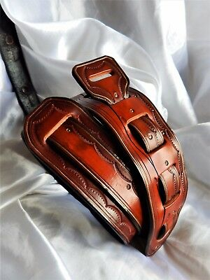 Lovely hand-made hand-carved quality leather guitar strap. Great price!!