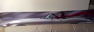 "Car poster - woman in silver E-type Jaguar, 60"" by 9"""