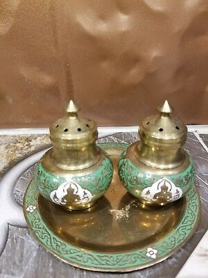 India ornate exotic Buddha vintage salt and pepper shakers, brass with tray.