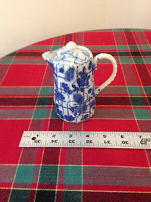 VINTAGE BLUE AND WHITE FLORAL PORCELAIN PITCHER with lid