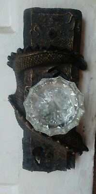 Glass door handle and ornate plate