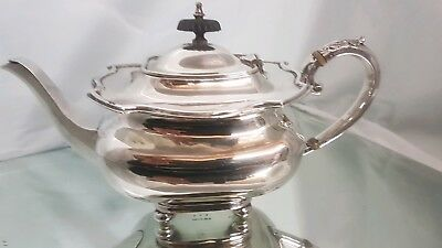 A very elegant vintage silver plated tea pot.stamped am&co.