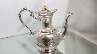 A beautifully engraved silver plated tea pot made in sheffield.very ornate.