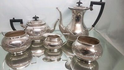 A beautiful antique silver plated 5 piece tea set with semi fluted pattern.rare.