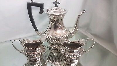 A beautiful vintage silver plated tea set with semi fluted pattern.by ehp