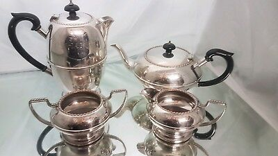 A beautiful vintage silver plated 4 piece tea set.with hand engraved patterns.