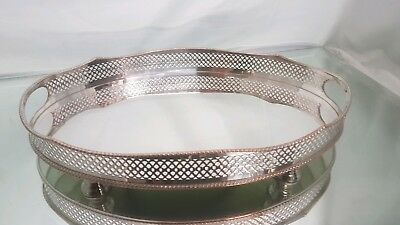 A vintage silver plated tray with a rise and fall gallery rail.very elegant.