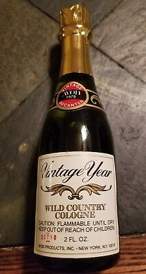 """Avon Wild Country After Shave - """"Vintage Year"""" Champagne Bottle - @ 6 inches"""