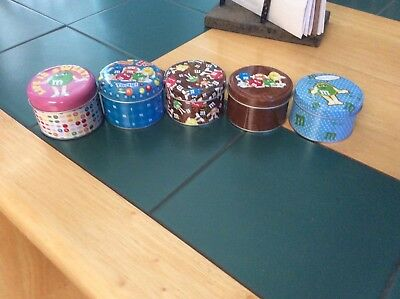m&m 5 tins w/ characters on them all different