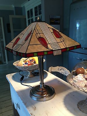 Replica very attractive. Tiffany style table lamp won't disappoint.