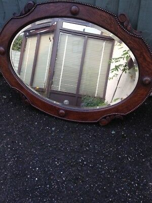 antique oval detailed wall mirror