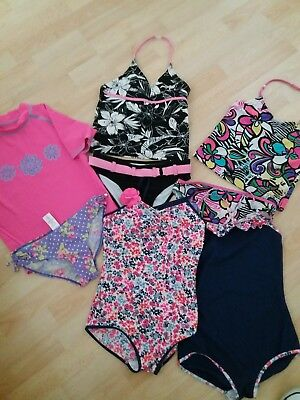girls age 11-12 swimwear bundle. Swimsuits, sun top and 2 piece sets.