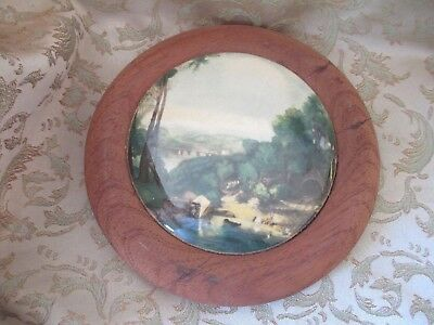Antique Pot Lid Mounted in Wooden Frame