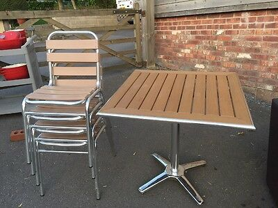 Patio set, table + 4 chairs. chrome