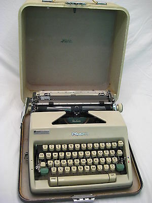 Vintage Olympia DeLuxe Portable Typewriter in Hard Case