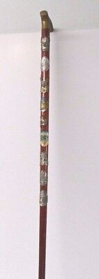 Walking stick with brass handle   3'  with many badges