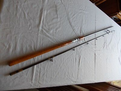 Vintage 9'6 CUSTOM BUILT HOLLOW GLASS SPINNING ROD -- In good useable condition.