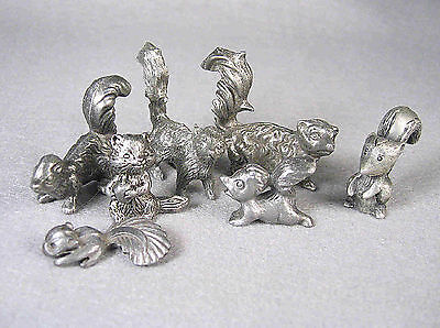 7 assorted Pewter Skunk Figurines in various size, weight & markings.
