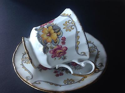 Elizabethan Cup and Saucer Roses Flowers scrolls Guilded