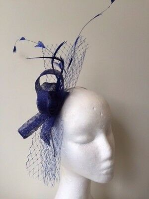 New blue loop, netting and feathered fascinator on a headband. Stunning on!