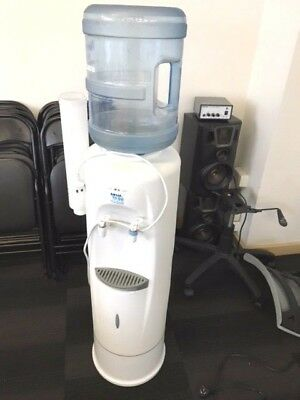 Water Cooler with empty bottle and stock of cups
