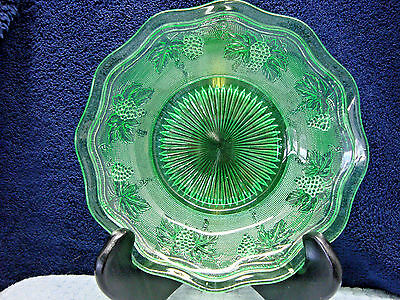 Green vaseline pressed glass footed bowl..