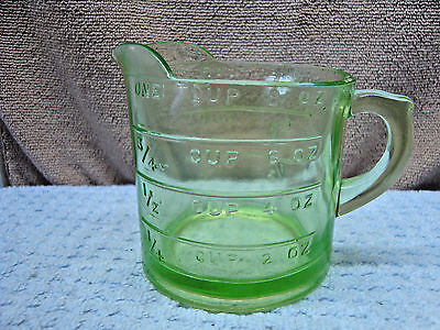 Green vaseline glass one cup measuring cup.