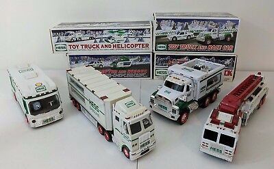8 Hess Trucks. Mixed Lot of 3 New In Box and 5 Used. Between years 1998 - 2012