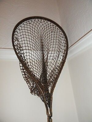 vintage old  landing net with hickory and brass handle. Good for Display only.