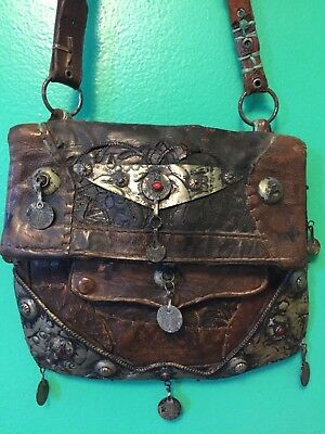 Moroccan antique leather bag with metal