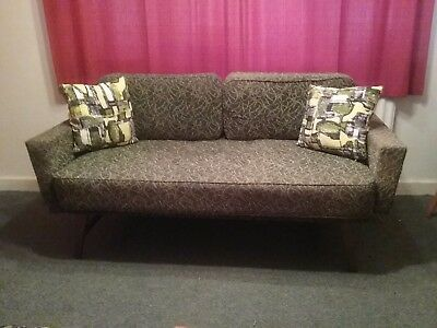 1950s sofabed green in colour,folds out to make bed