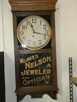 Antique Ingraham Regulator Style Wall Clock with Jewelers Name painted on Glass
