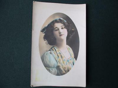 """Real Photo Pc. """"  Young Girl With Ribbon & Floral Dress  """"  Posted  1912"""