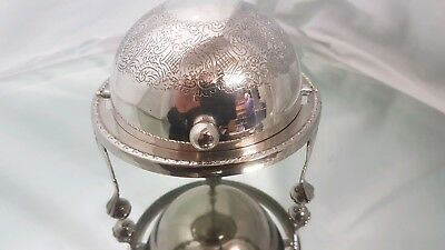 A vintage silver plated roll top butter/caviar dish on pawed legs.very ornate.