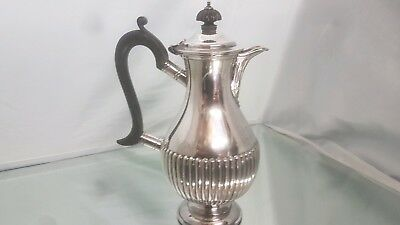 An antique silver plated tea pot by william hutton sheffield.very ornate.