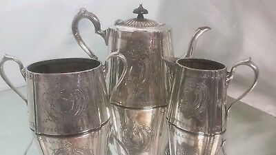 An antique silver plated tea set with engraved patterns.daniel & arter.