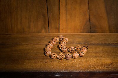 A chinese antique carved nut prayer beads